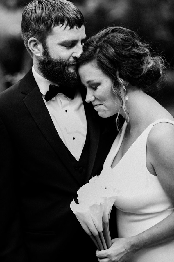 Groom kisses his wife.