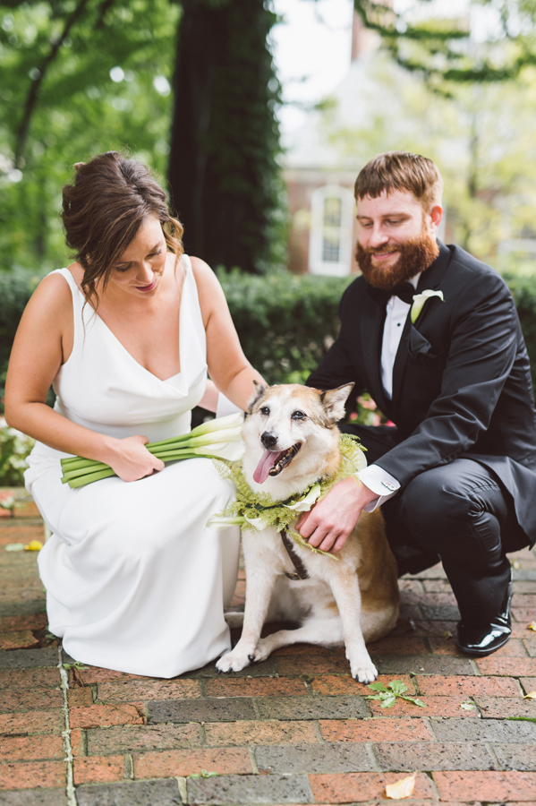 Bride and groom portrait with their dog.