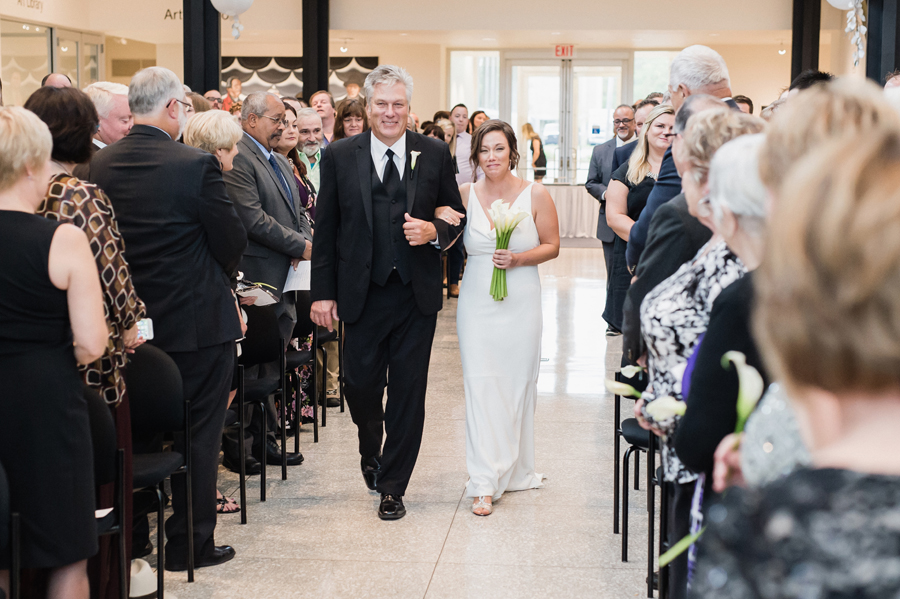 Bride walks with her dad down the aisle.