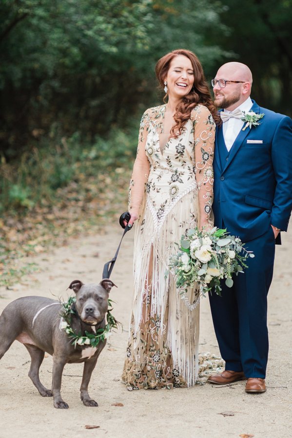 Bride and groom with their flower dog.