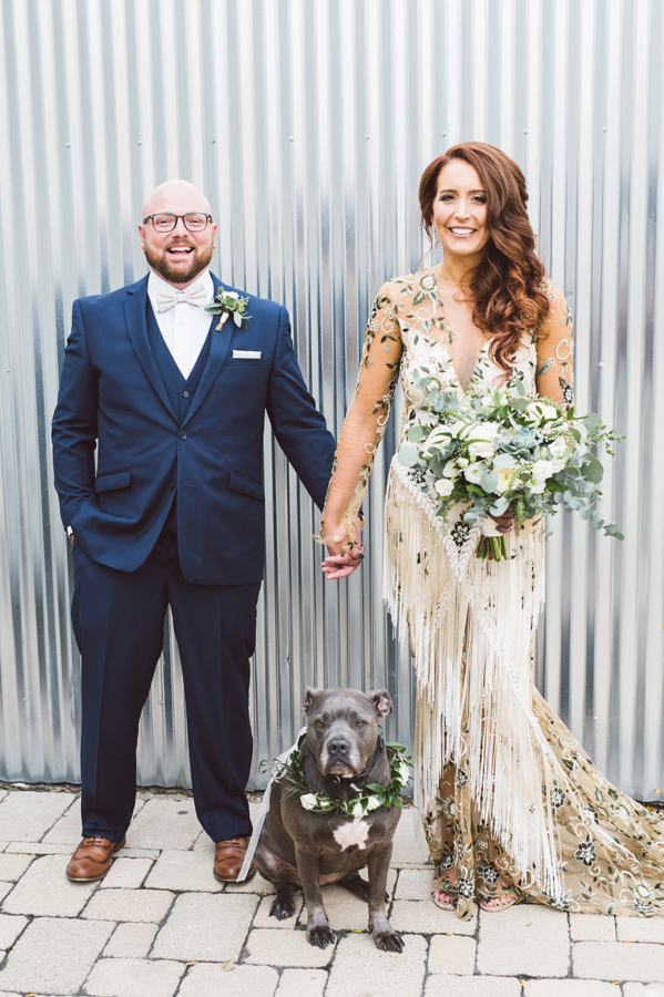 Bride and groom and their dog.