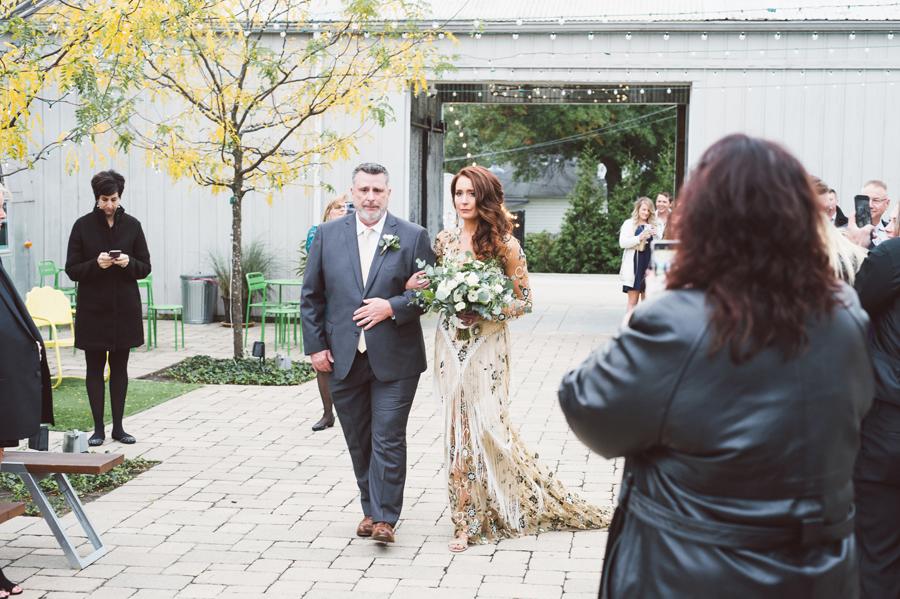 Dad walks bride down the aisle.