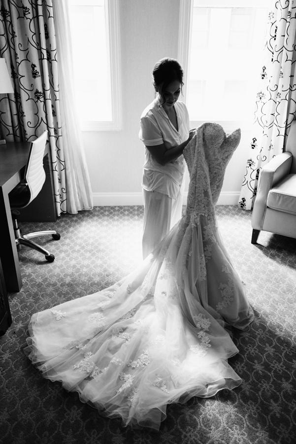 Bride gets in dress.