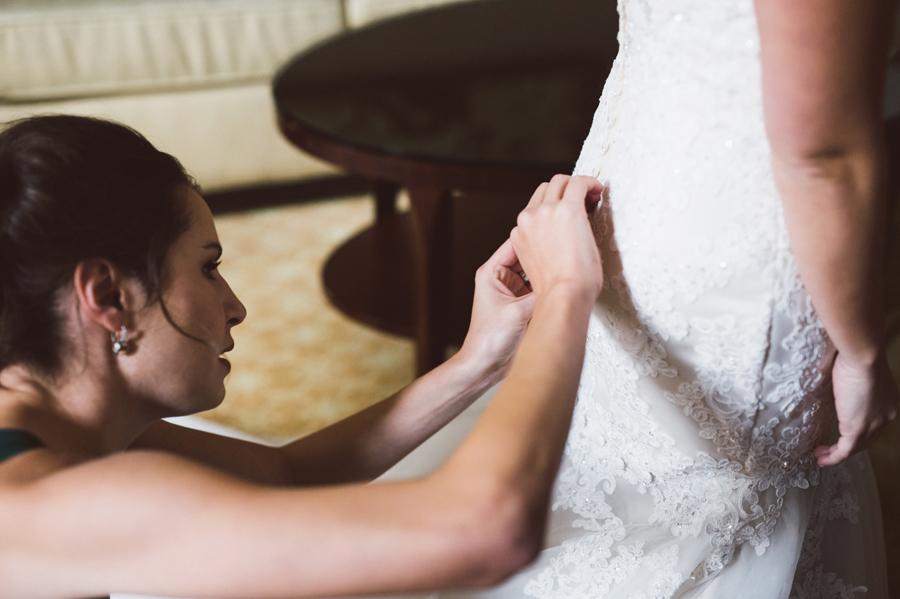 Bride gets in dress