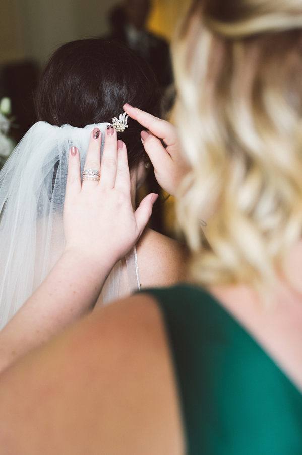 Bride gets her veil put on.