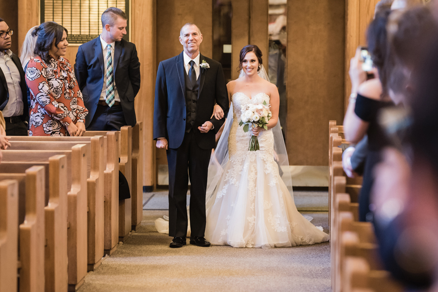 Bride and her dad walk down the aisle.