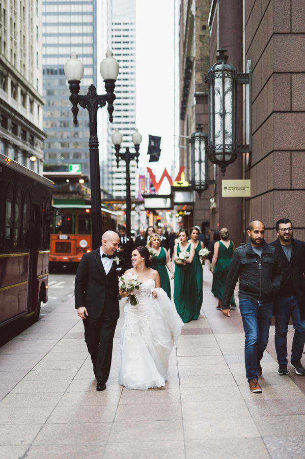 Bride and groom walk around downtown Chicago.