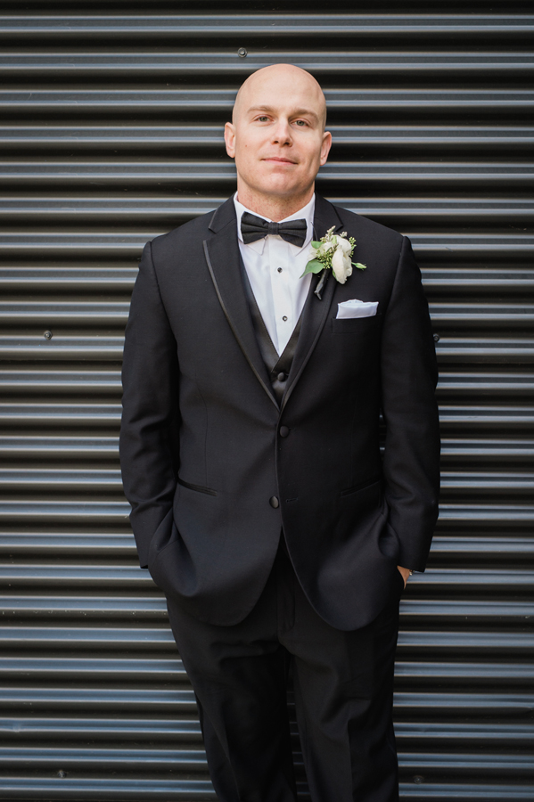 Portrait of groom at Ignite Glass Studio.