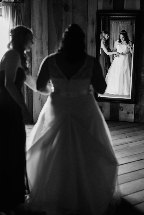 Bride gets in her dress.