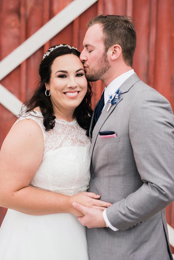 Groom kisses his bride.