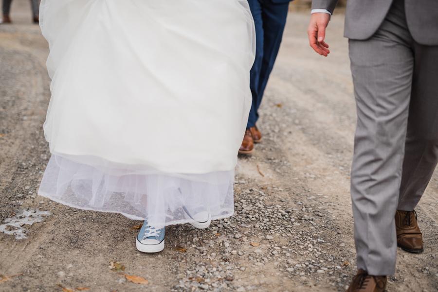 Bride wears chuck taylors.