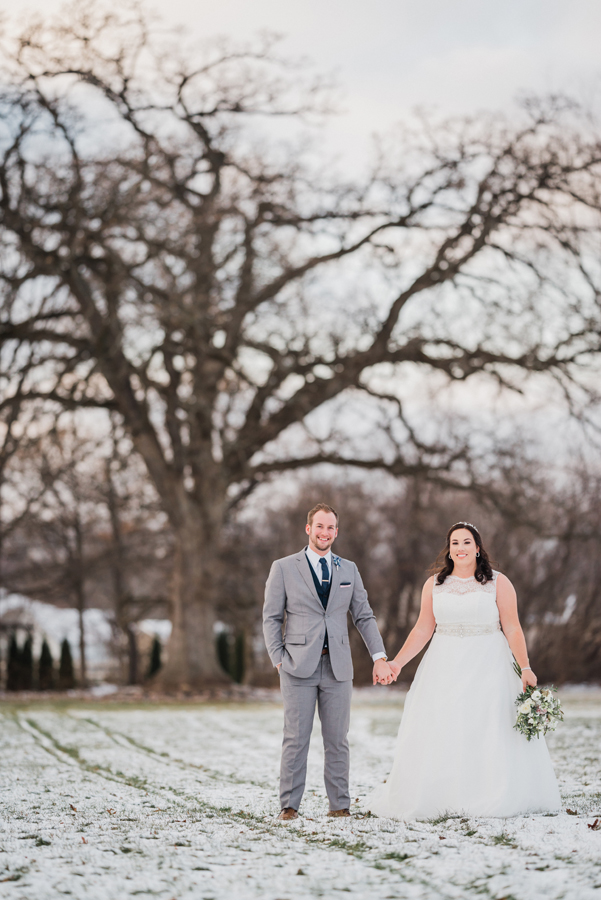 Portrait of bride and groom in snow.