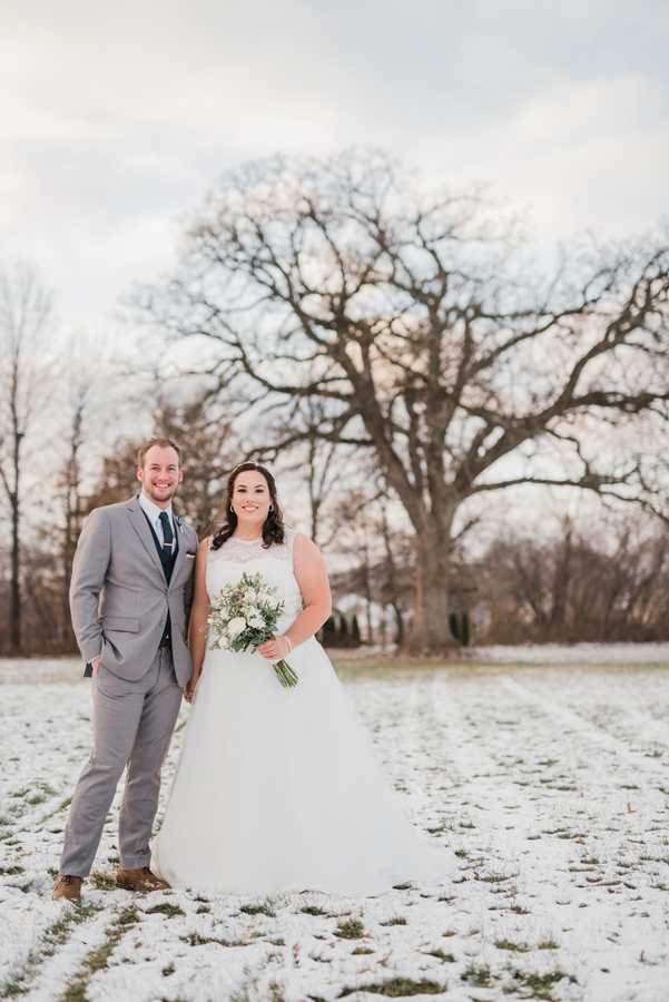 Bride and groom in snow.