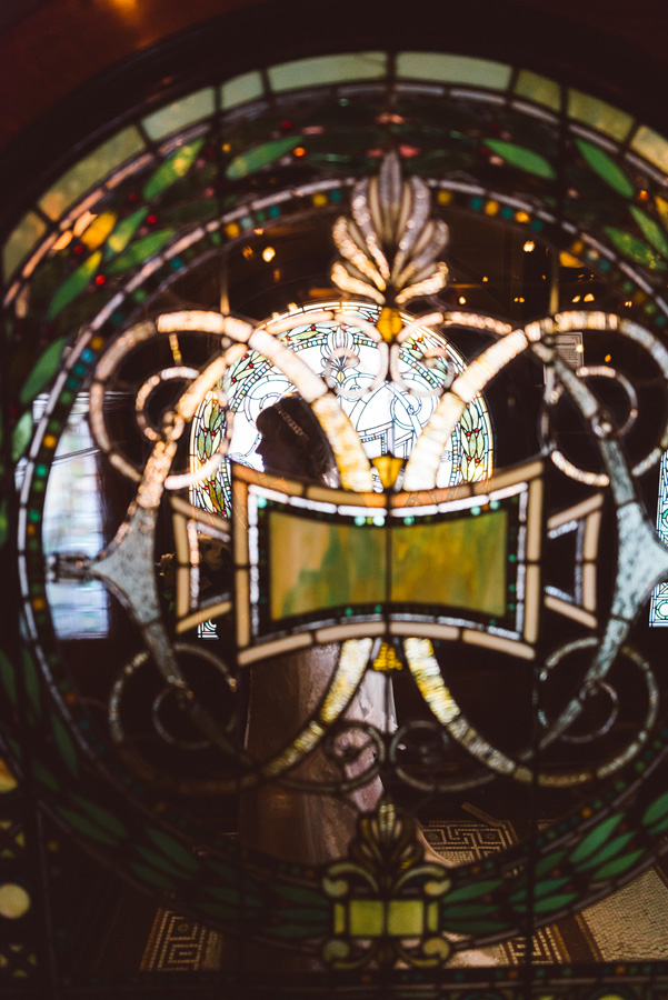 Bride's portrait with stained glass windows at Pleasant Home.