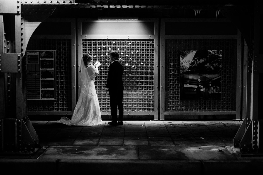 Bride and groom put up a lock in Oak Park.