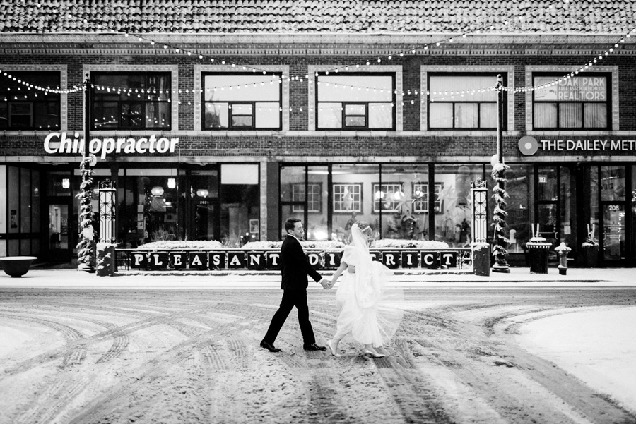 Bride and groom downtown Oak Park on a snowy day.
