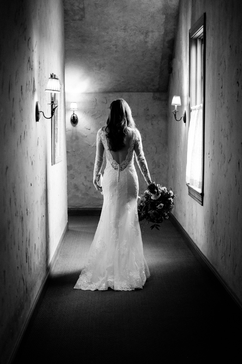 Bride walks down hallway at the Herrington Inn.