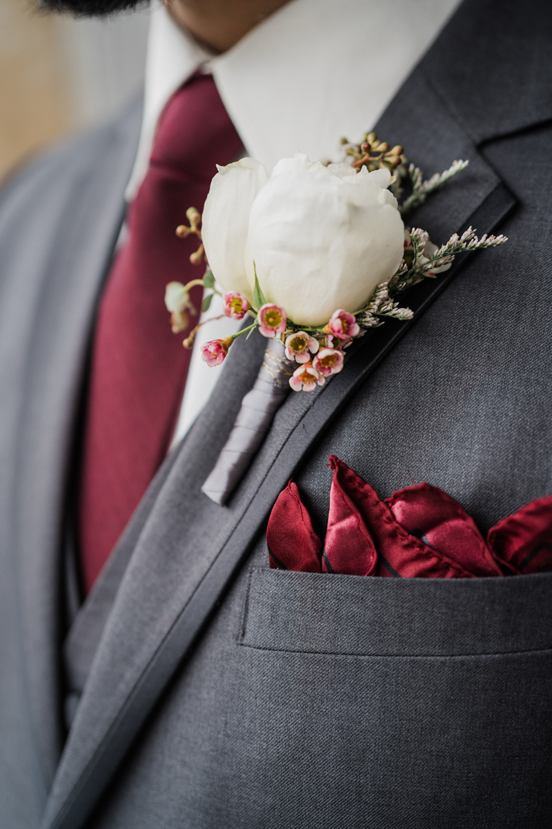 Detail photo of grooms flower.