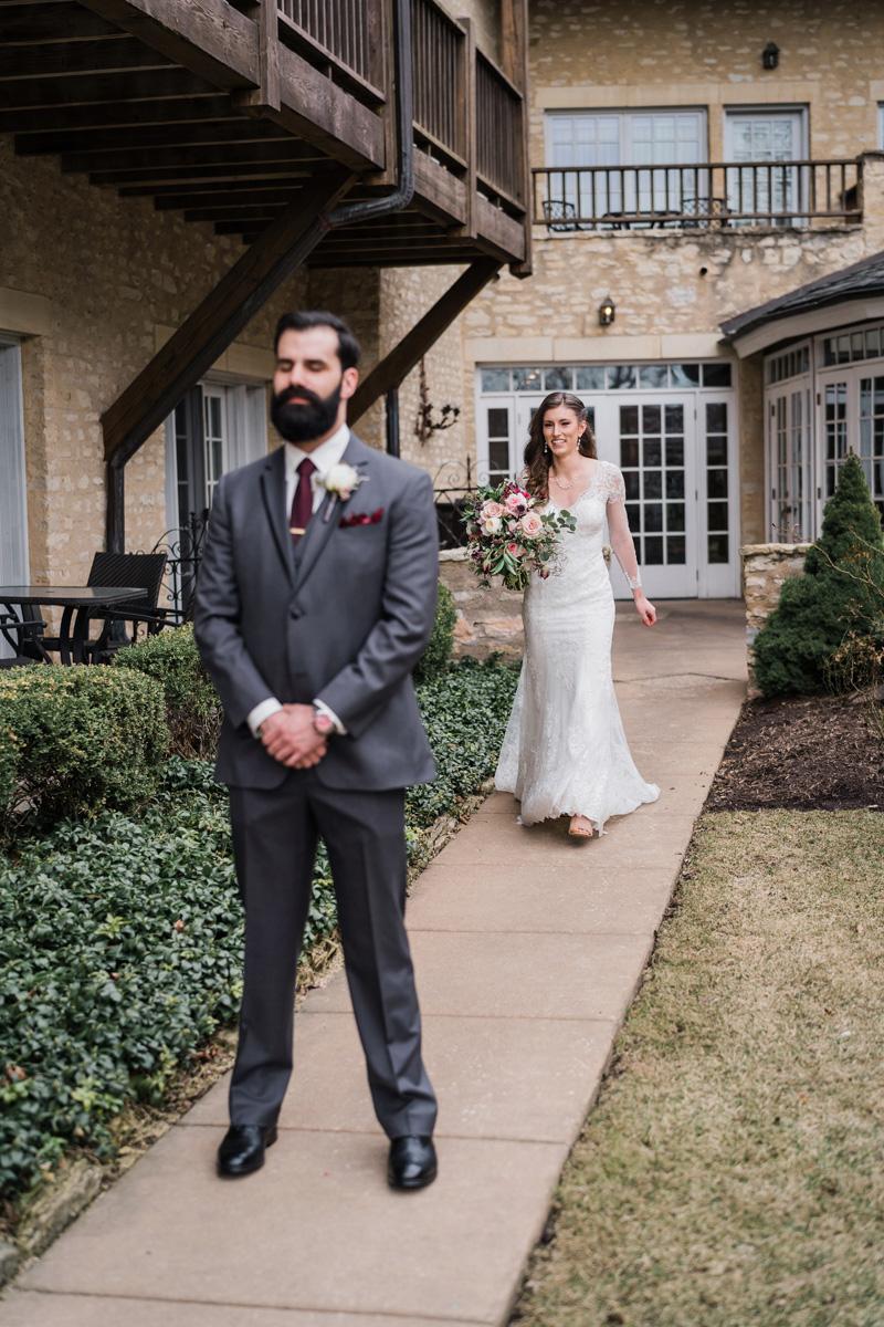 bride and groom first look at the Herrington Inn.