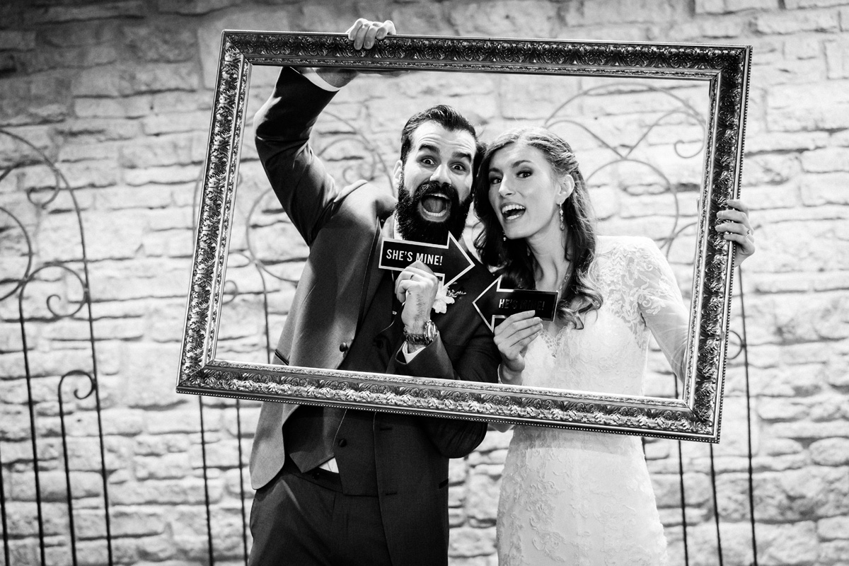 Bride and groom in photo booth.