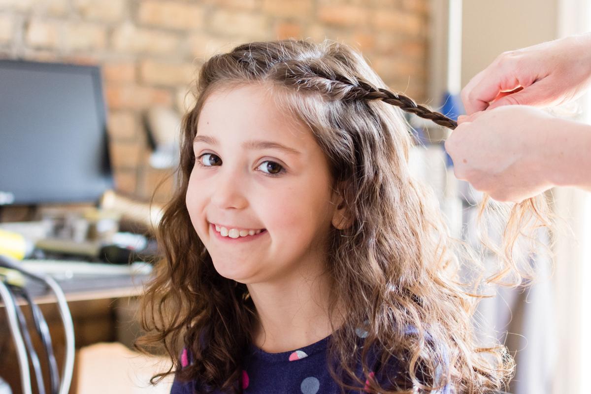 Flower girl getting her hair done.