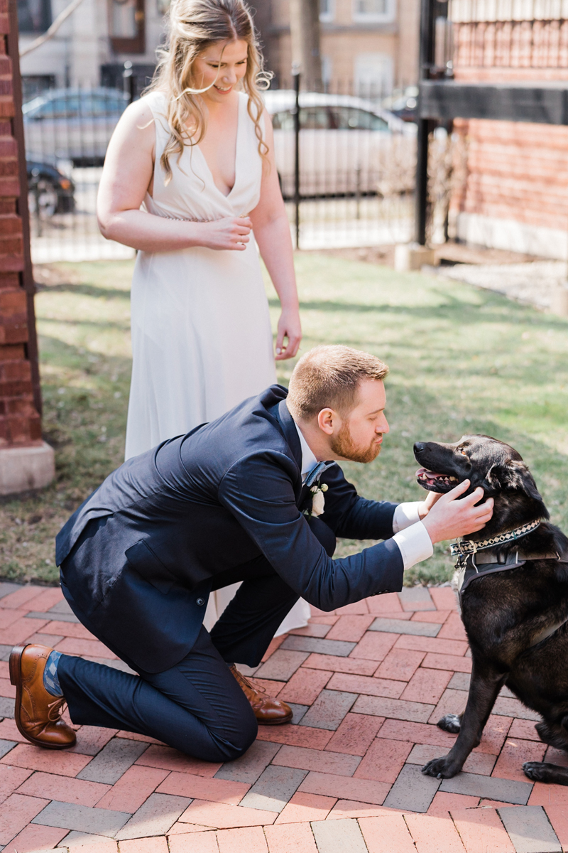 Bride and groom with their dog.
