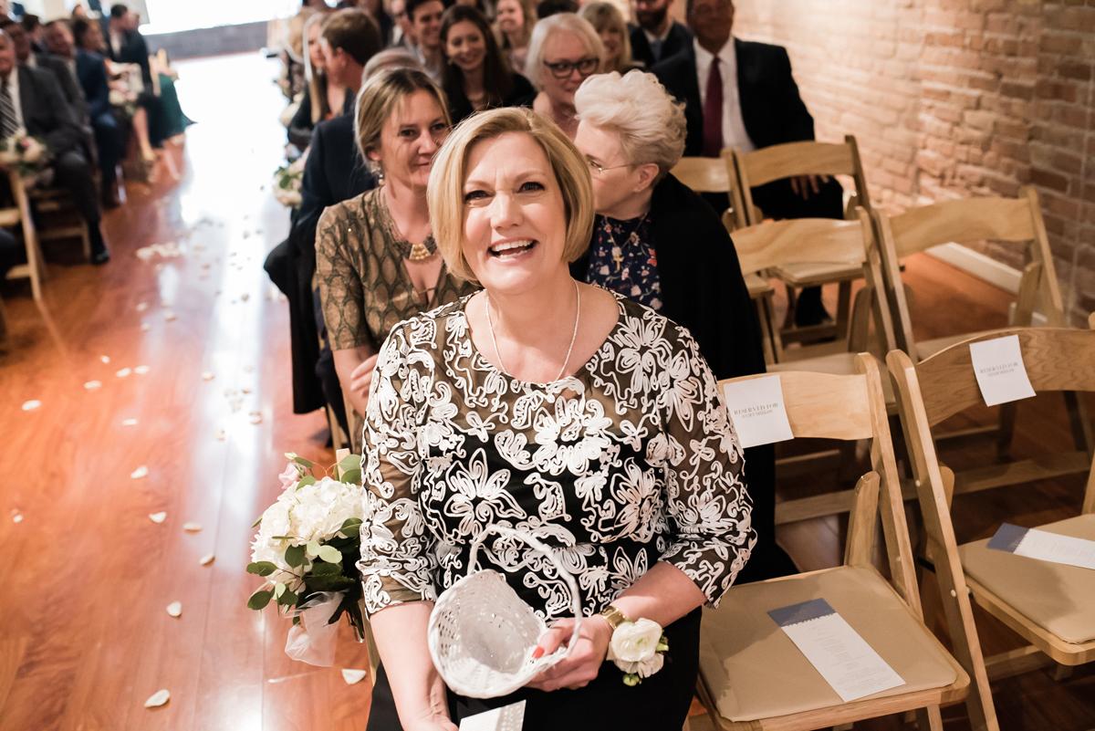 Bride's mom at wedding ceremony.