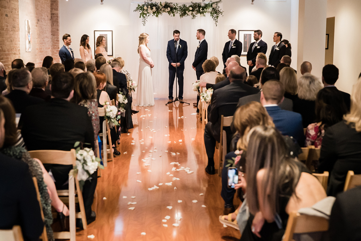 Overall photo of wedding ceremony at Floating World Gallery.