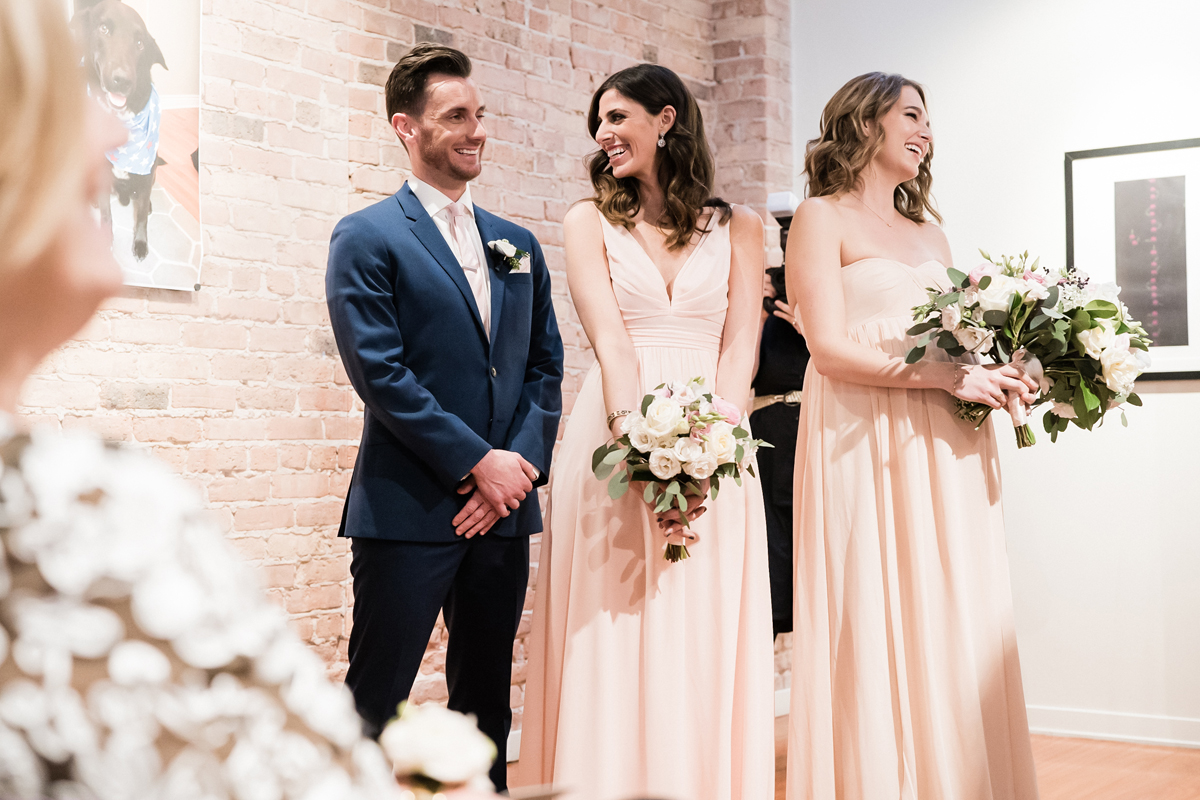 Bridal party reacts during wedding ceremony.