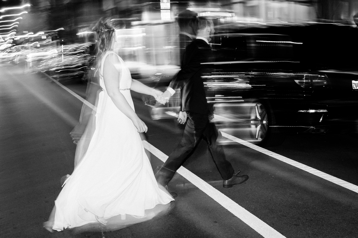 Bride and groom walk across Halsted in Chicago.