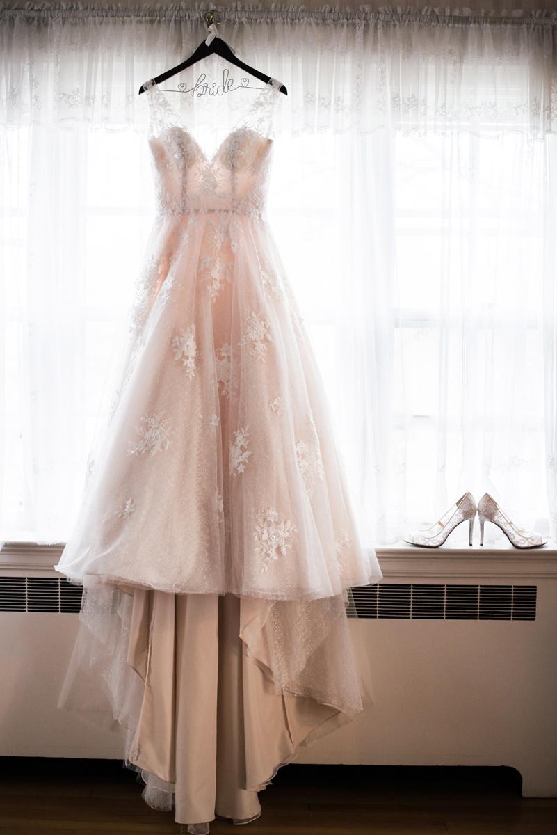 Bride's dress hanging up.
