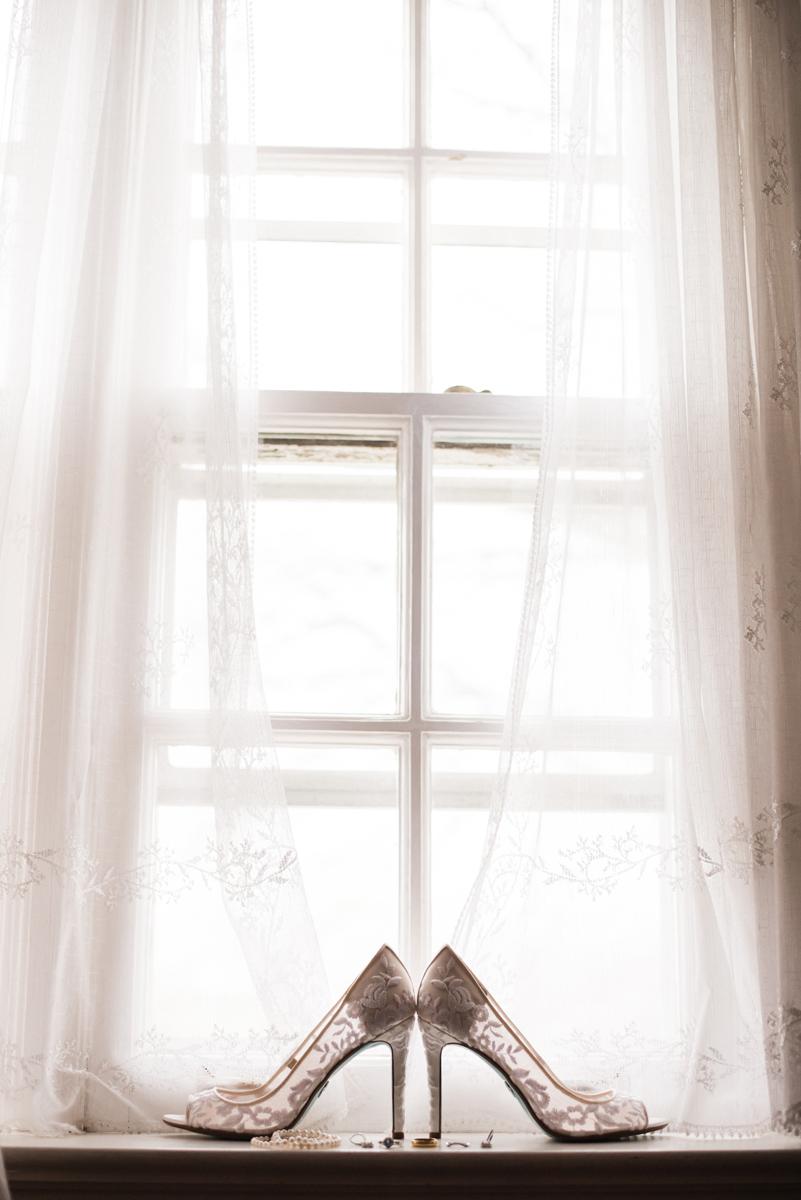 Bride's shoes in window.