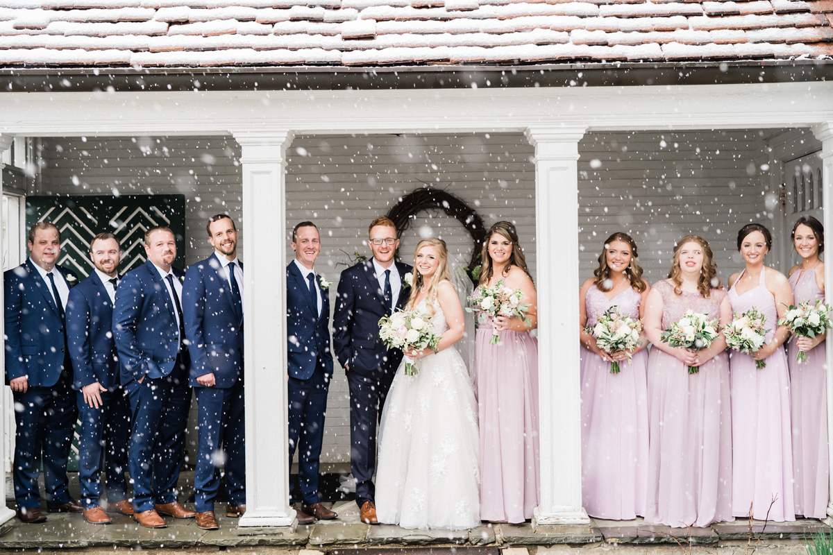 Snowy bridal party portrait.