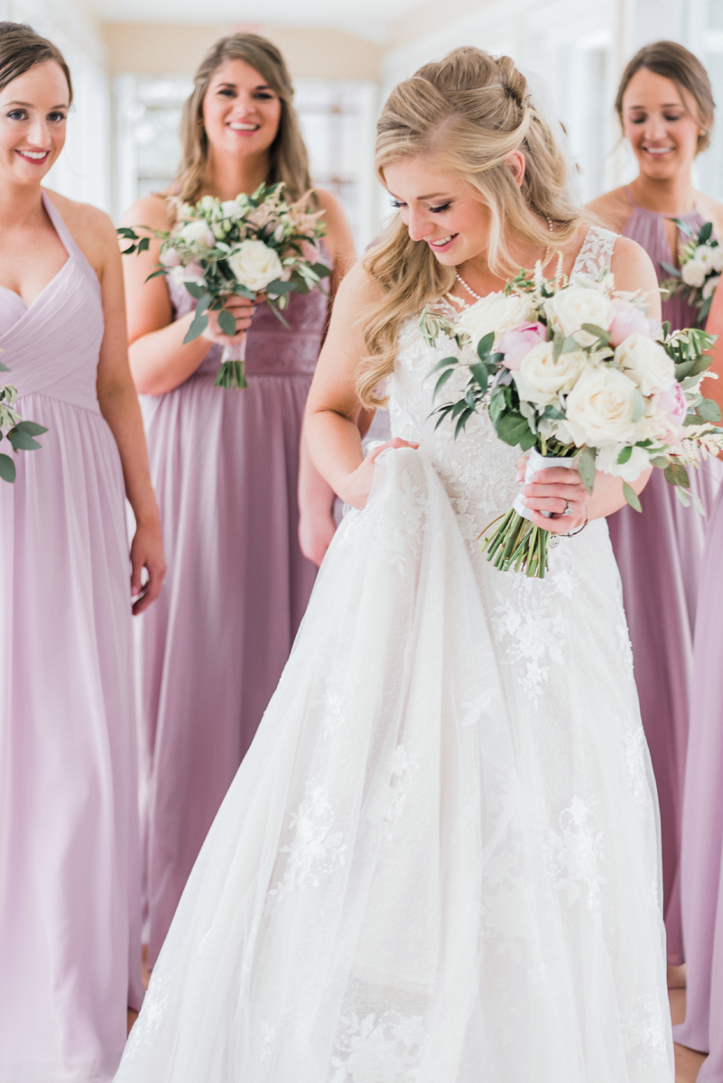 Candid of bride with bridesmaids.
