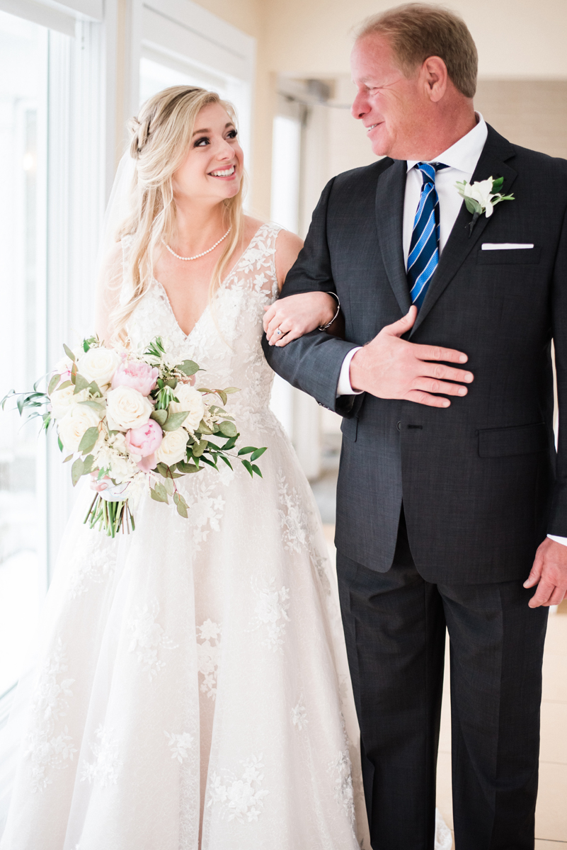 Dad walks his daughter down the aisle.