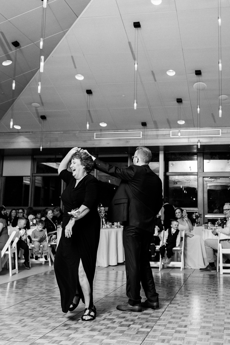 Mom and son dance.