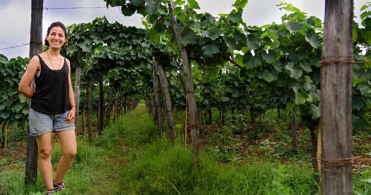 Baia standing on her organic vineyard in Georgia