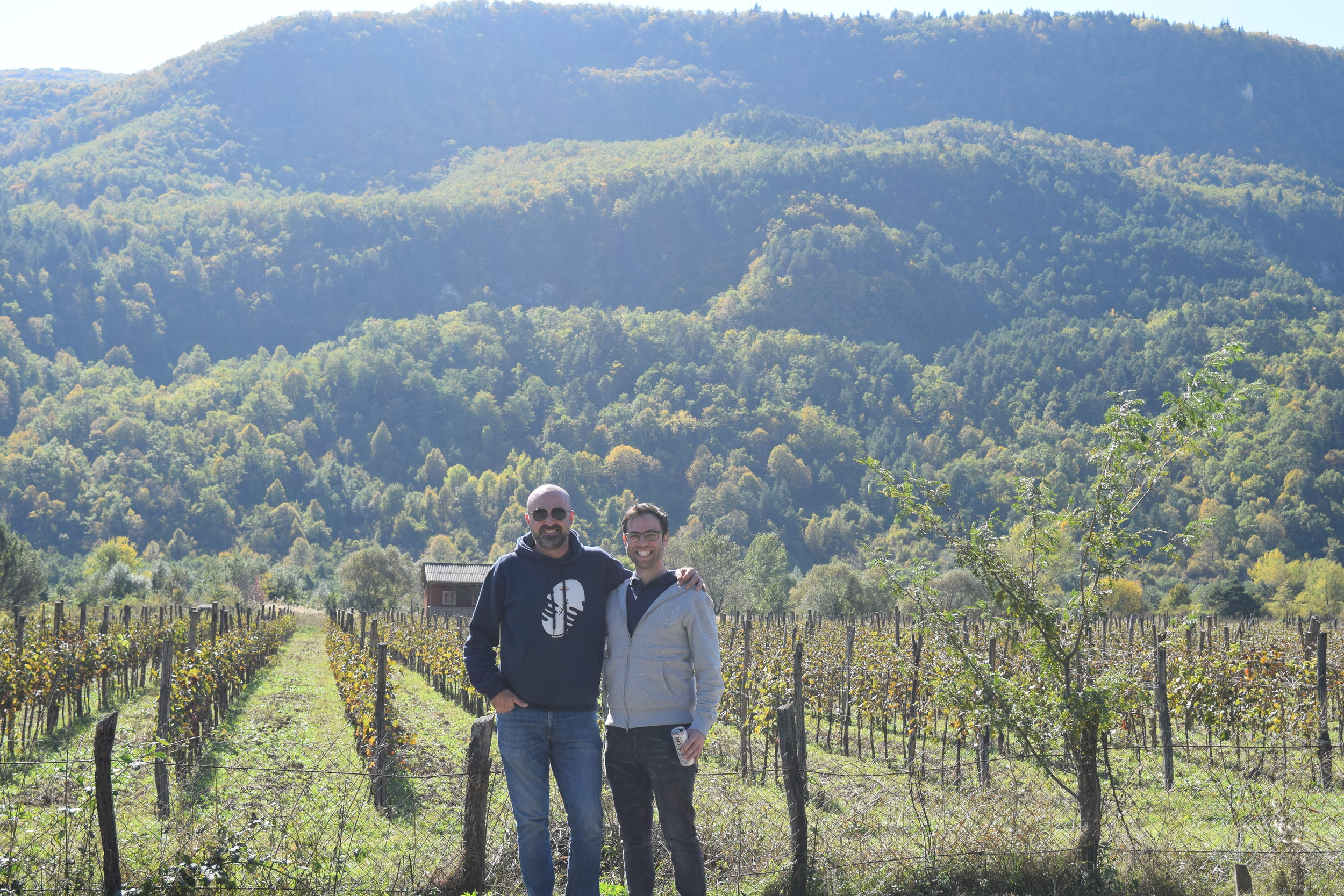 The two founders posing for a photograph in a vineyard in Racha Georgia, where Royal Khvanchkara wine is made