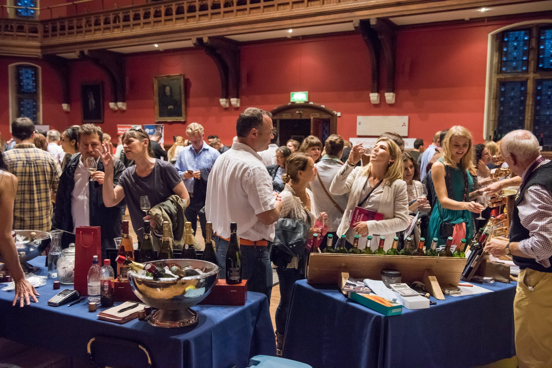 A busy room full of people tasting lots of different wines in the UK. For example biodynamic, organic and qvevri wine from Georgia.