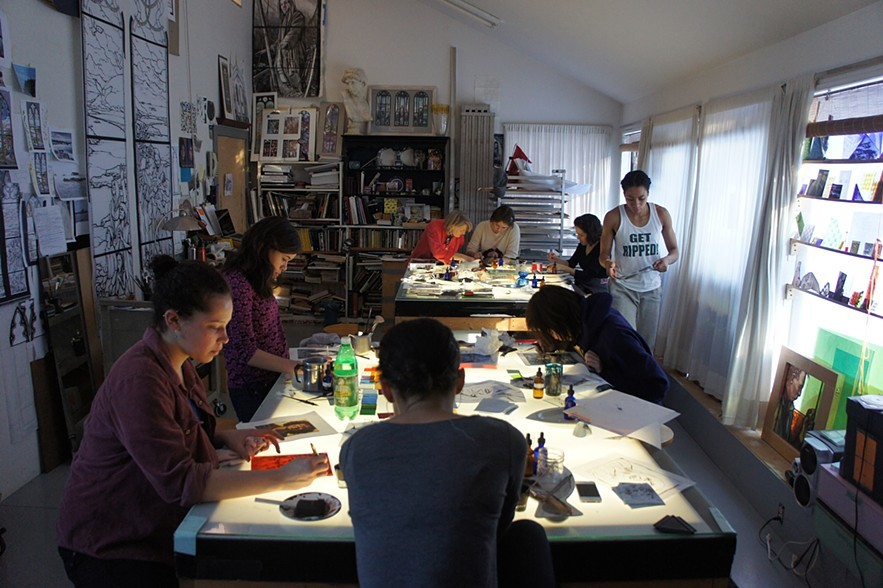 students from Williams College Massachusetts painting self portraits in stained glass