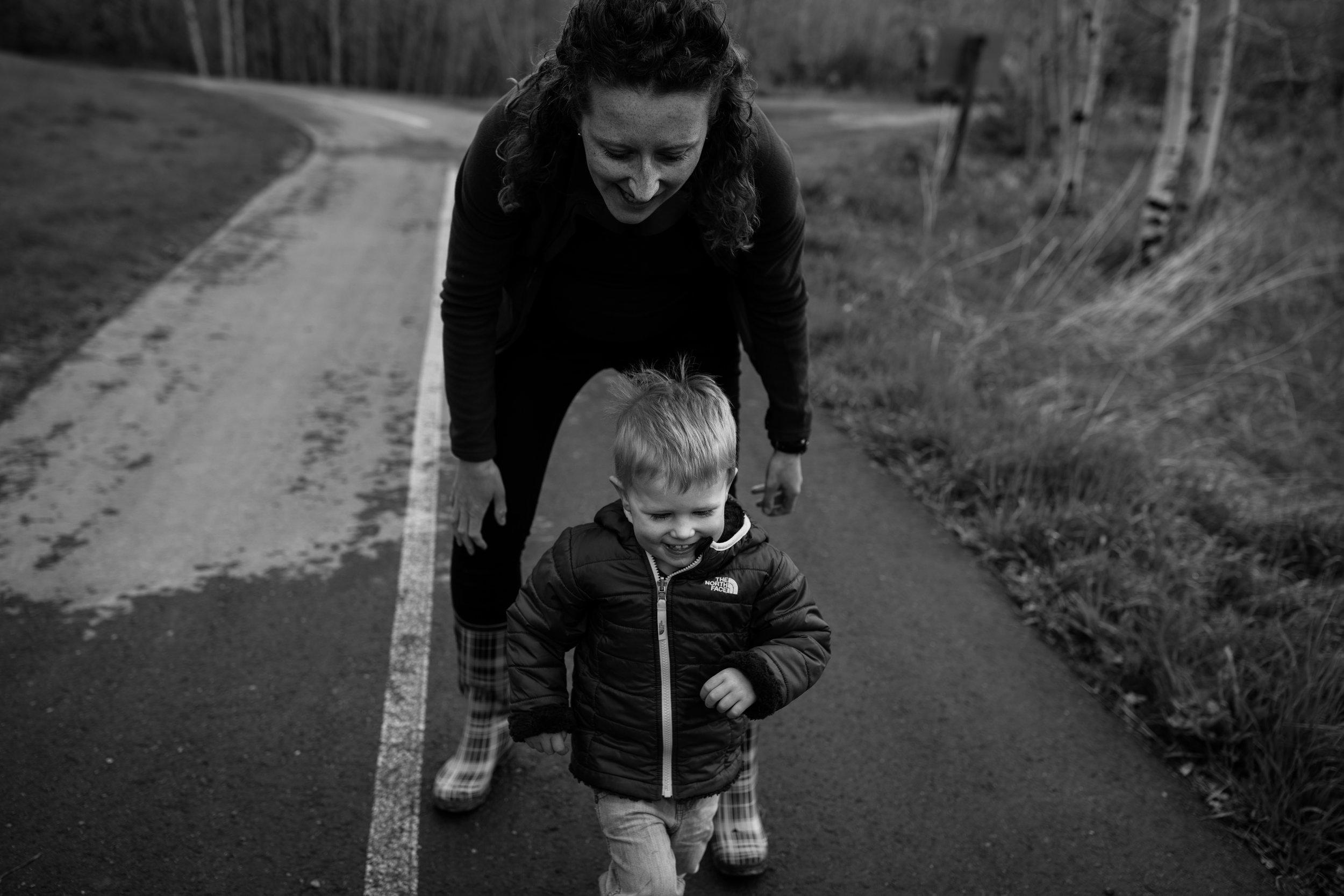 pregnant mom chasing toddler