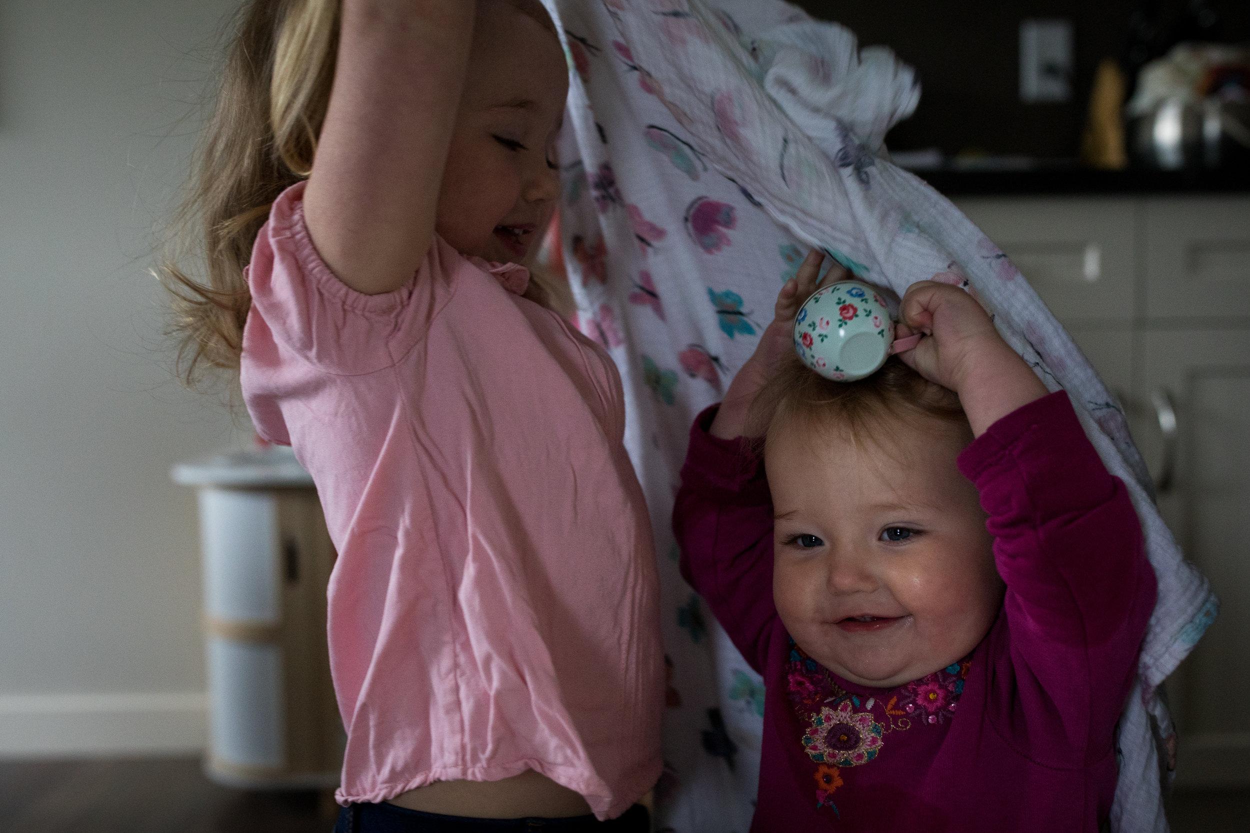 sibling playing peek a boo