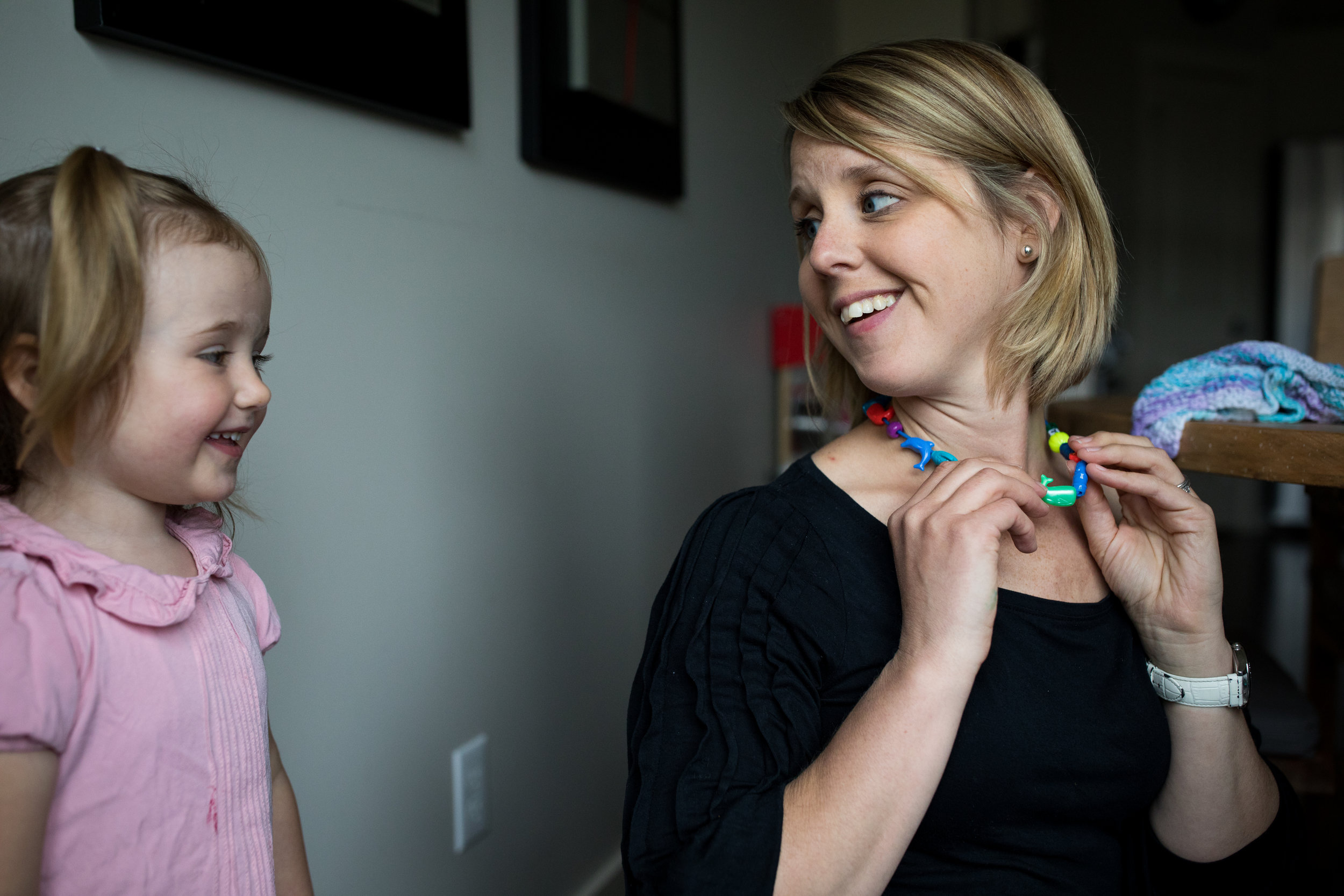 mom gets necklace from toddler