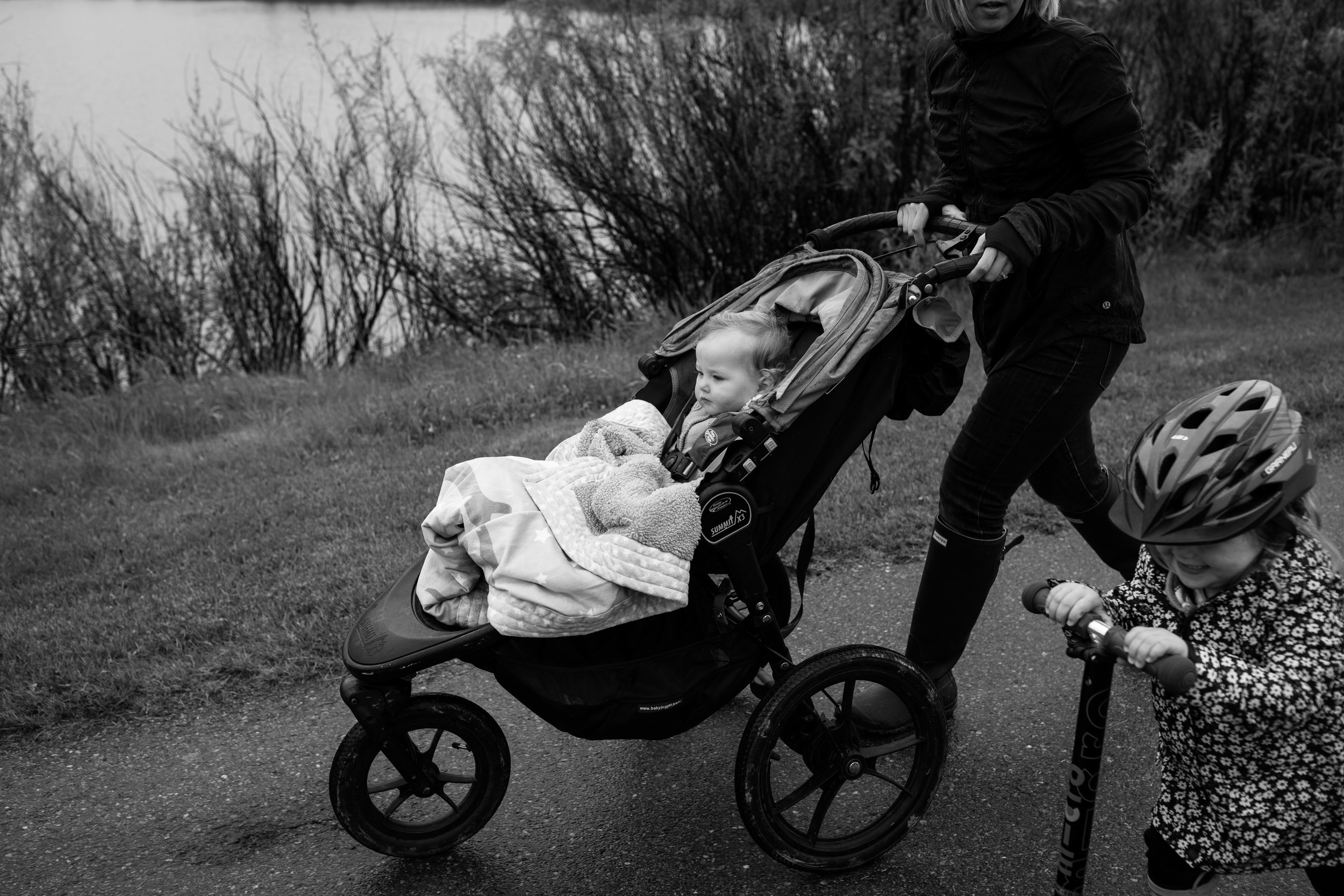 rainy walk with stroller and scooter