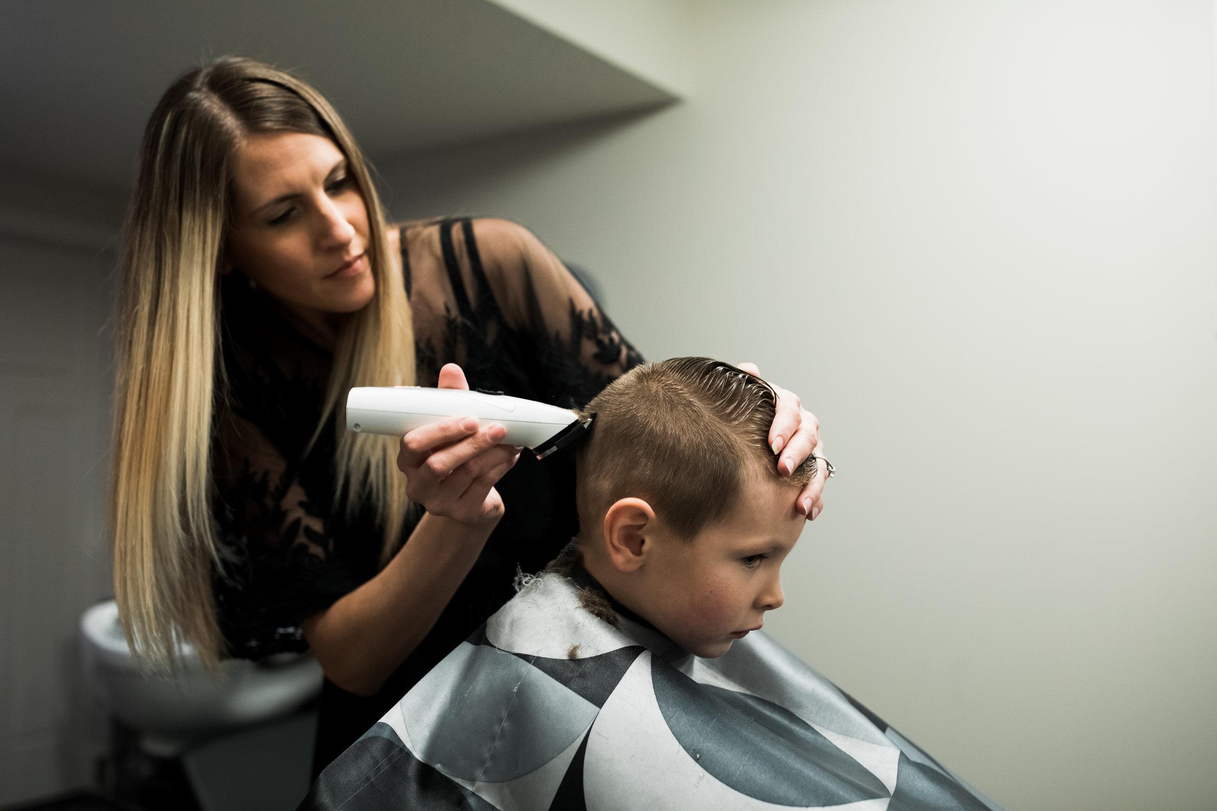 mom gives his son haircut