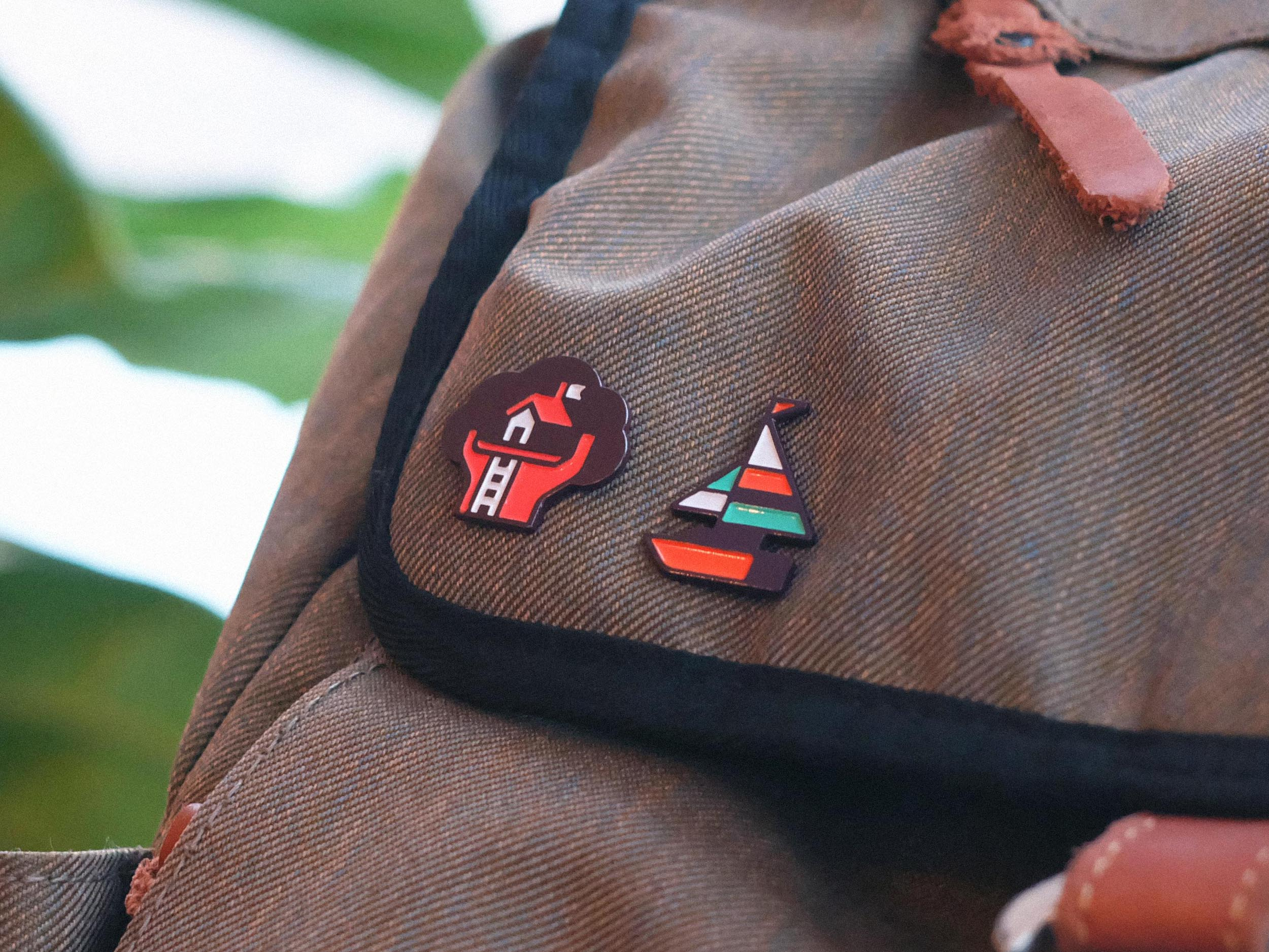 Enamel Pins - Our pins are made with die struck metal which is filled with a recessed enamel layer. This allows us to incorporate bright colors and bold designs into durable and portable works of art.