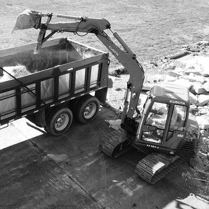 Clark-trackhoe-and-truck-in-use_BW.jpg