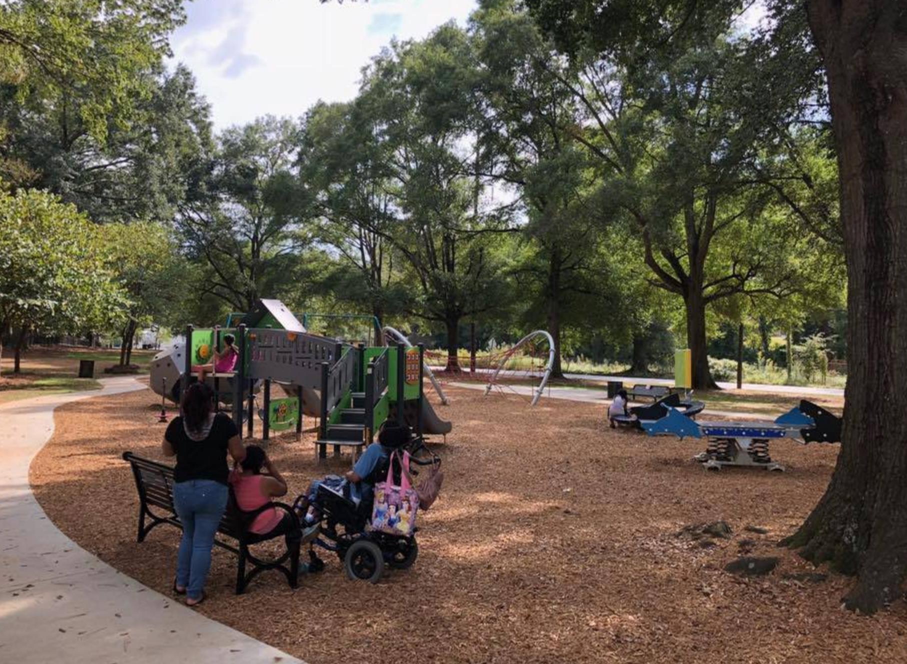 A special needs family enjoying the park.