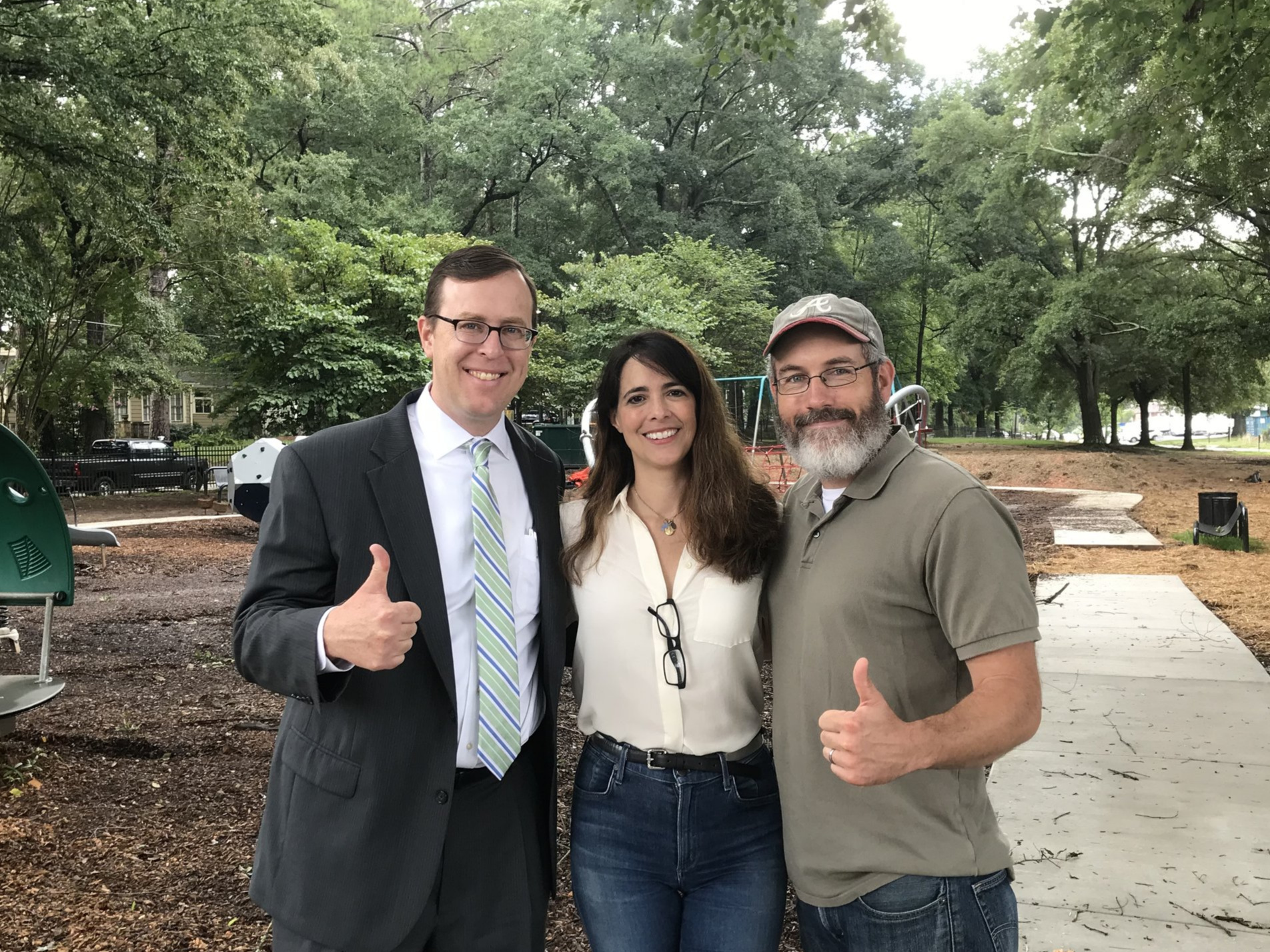 Michael Halicki, Park Pride Executive Director (left); González Whitaker; John Ahern, Park Pride Volunteer Manager, at the Sara J. González Park while it was under construction, 2018.