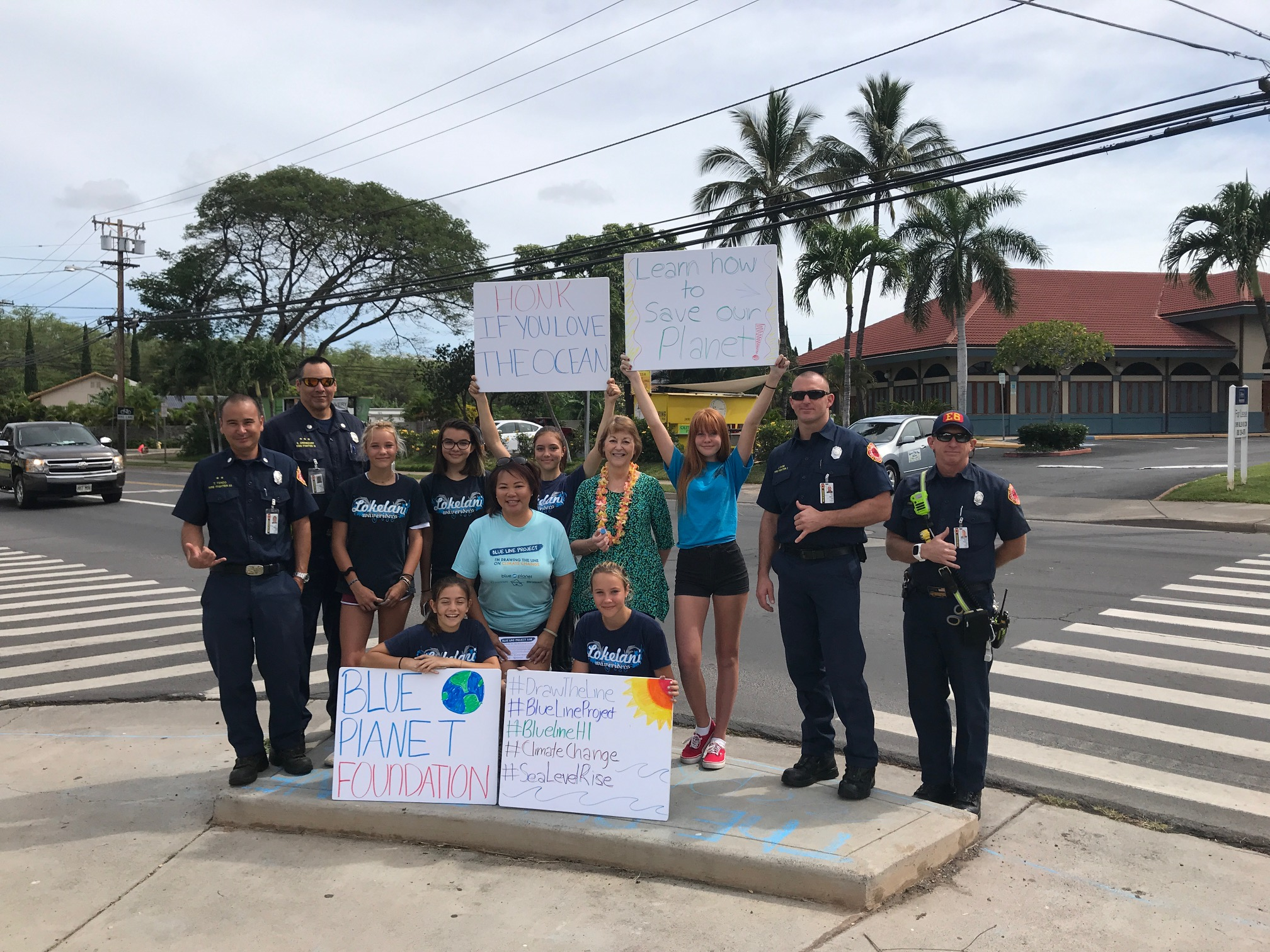 "Thousands of students and community members joined Blue Planet Foundation in drawing ""blue lines"" in chalk to mark the sea level rise exposure area around Hawai'i.   (April 21, 2018)"
